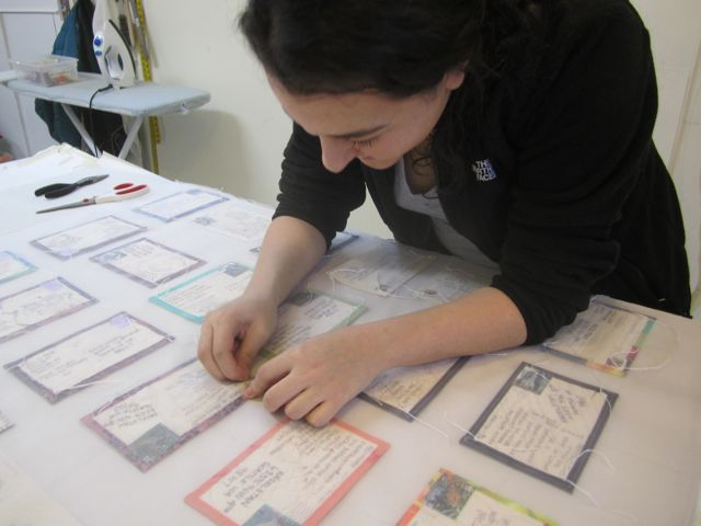 Talia sewing the postcards to the organza