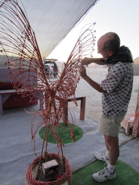 Alan attaching the first wish to the Fire Bird