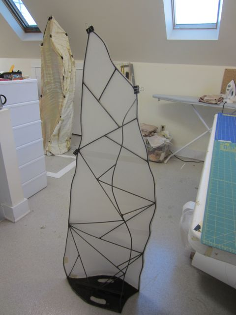 fitting paper patterns to the steel frame
